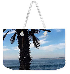 Weekender Tote Bag featuring the photograph Palm Waves by Susan Garren