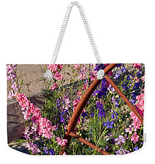 Pastel Colored Larkspur Flowers With Rusty Wagon Wheel Art Prints Weekender Tote Bag