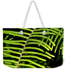Weekender Tote Bag featuring the photograph Pauched Coral Fern by Miroslava Jurcik