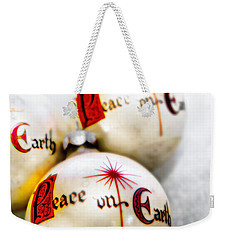 Weekender Tote Bag featuring the photograph Antique Peace On Earth Christmas Decorations by Vizual Studio