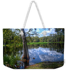 Weekender Tote Bag featuring the photograph Peaceful Florida by Timothy Lowry