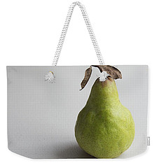 Weekender Tote Bag featuring the photograph Pear Still Life Protrait by Jocelyn Friis
