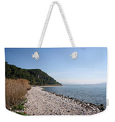 Weekender Tote Bag featuring the photograph Pebbled Beach by Tracey Harrington-Simpson