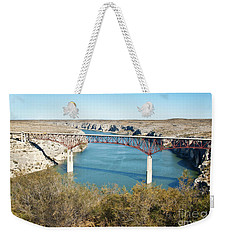 Weekender Tote Bag featuring the photograph Pecos Bridge by Erika Weber