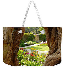 Weekender Tote Bag featuring the photograph Peek At The Garden by Vicki Spindler
