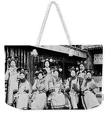 Weekender Tote Bag featuring the photograph Peking Palace Women by Granger