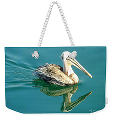Weekender Tote Bag featuring the photograph Pelican In San Francisco Bay by Clare Bevan