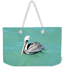 Weekender Tote Bag featuring the photograph Pelican by Oksana Semenchenko
