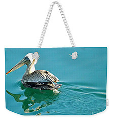 Weekender Tote Bag featuring the photograph Pelican Swimming by Clare Bevan