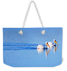 Weekender Tote Bag featuring the photograph Pelicans On The Bay by AJ  Schibig