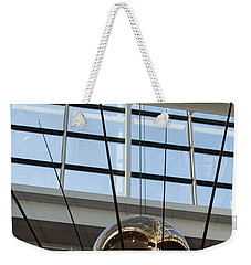 Weekender Tote Bag featuring the photograph Pendulum by Patricia Babbitt