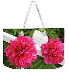 Weekender Tote Bag featuring the photograph Peonies Resting On White Fence by Barbara Griffin