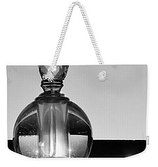Weekender Tote Bag featuring the photograph Perfume Bottle Inversion by Lilliana Mendez