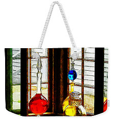 Weekender Tote Bag featuring the photograph Pharmacist - Colorful Bottles In Drug Store Window by Susan Savad