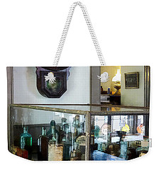 Weekender Tote Bag featuring the photograph Pharmacist - Corner Drug Store by Susan Savad