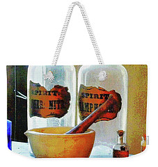 Weekender Tote Bag featuring the photograph Pharmacist - Mortar And Pestle With Bottles by Susan Savad