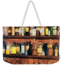 Weekender Tote Bag featuring the photograph Pharmacist - Mortar Pestles And Medicine Bottles by Susan Savad