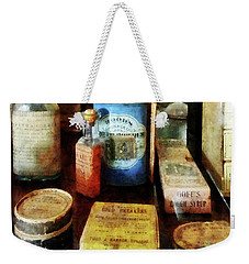 Weekender Tote Bag featuring the photograph Pharmacy - Cough Remedies And Tooth Powder by Susan Savad