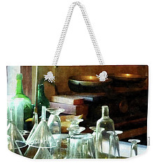 Weekender Tote Bag featuring the photograph Pharmacy - Glass Funnels And Bottles by Susan Savad