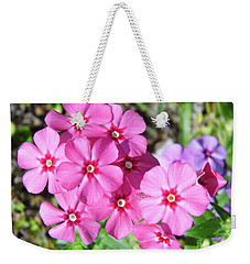 Weekender Tote Bag featuring the photograph Phlox Beside The Road by D Hackett