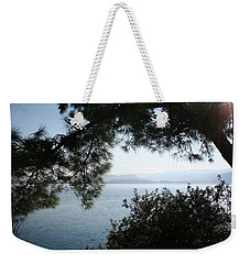 Weekender Tote Bag featuring the photograph Pine Trees Overhanging The Aegean Sea by Tracey Harrington-Simpson