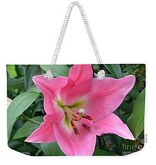 Weekender Tote Bag featuring the photograph Pink Lily by Jeannie Rhode