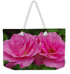 Weekender Tote Bag featuring the photograph Pink Passion by James C Thomas