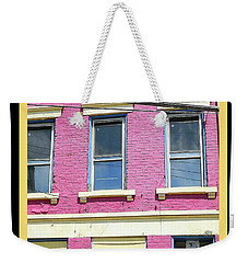 Weekender Tote Bag featuring the photograph Pink Yellow Blue Building by Kathy Barney