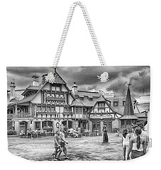 Weekender Tote Bag featuring the photograph Pinocchio's Village Haus by Howard Salmon