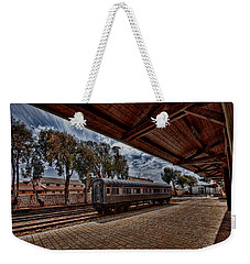 Weekender Tote Bag featuring the photograph platform view of the first railway station of Tel Aviv by Ron Shoshani