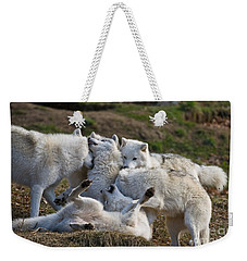 Weekender Tote Bag featuring the photograph Playful Pack by Wolves Only