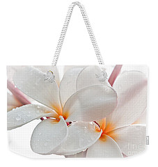 Weekender Tote Bag featuring the photograph Plumeria by Roselynne Broussard