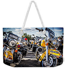 Weekender Tote Bag featuring the photograph Police Motorcycle Lineup by Eleanor Abramson
