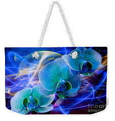 Weekender Tote Bag featuring the photograph Prismatic Orchid Swirl by Judy Palkimas