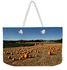 Weekender Tote Bag featuring the photograph Pumpkin Field by Michael Gordon