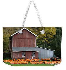 Weekender Tote Bag featuring the photograph Pumpkins by PJ Boylan