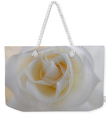 Weekender Tote Bag featuring the photograph Purity by Deb Halloran