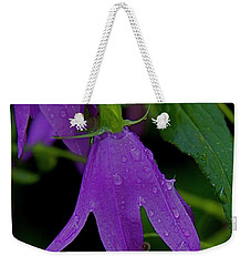 Weekender Tote Bag featuring the photograph Purple by Daniel Sheldon
