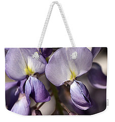 Weekender Tote Bag featuring the photograph Purple Of Wisteria by Joy Watson