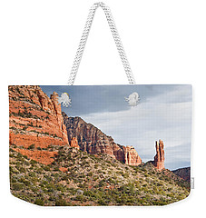 Weekender Tote Bag featuring the photograph Rabbit Ears Spire At Sunset by Jeff Goulden