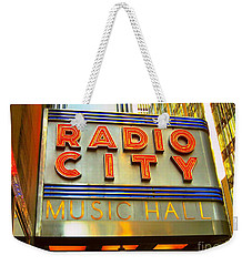 Weekender Tote Bag featuring the photograph Radio City Music Hall by Judy Palkimas