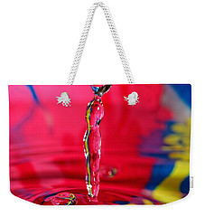 Weekender Tote Bag featuring the photograph Rainbow Drop by Peter Lakomy