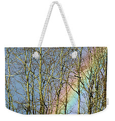 Weekender Tote Bag featuring the photograph Rainbow Hiding Behind The Trees by Kristen Fox