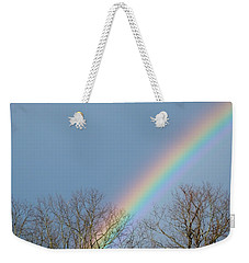 Weekender Tote Bag featuring the photograph Rainbow Through The Tree Tops by Kristen Fox