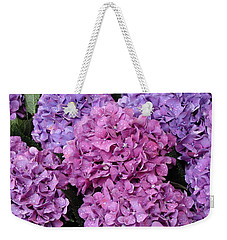 Weekender Tote Bag featuring the photograph Rainy Day Flowers by Ira Shander