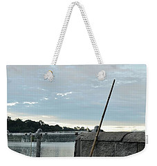 Weekender Tote Bag featuring the photograph Rake Rests Itself After A Hard Days Work by Imran Ahmed