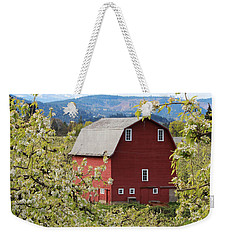 Weekender Tote Bag featuring the photograph Red Barn And Apple Blossoms by Patricia Babbitt