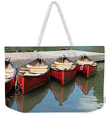 Weekender Tote Bag featuring the photograph Red Canoes by Marcia Socolik