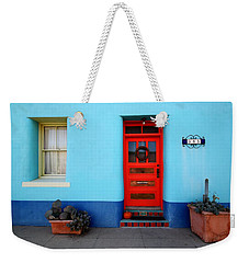 Red Door On Blue Wall Weekender Tote Bag by Joe Kozlowski