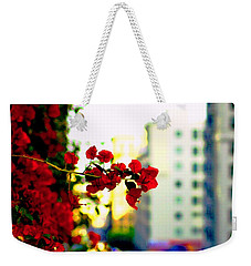 Weekender Tote Bag featuring the photograph Red Flowers Downtown by Matt Harang